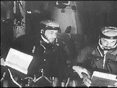 Volkov a Dobrovolskij na palubě Saljutu (v pozadí kužel komplexu ONA)