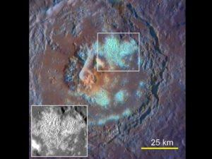 Bílo-modré propadliny na povrchu planety.