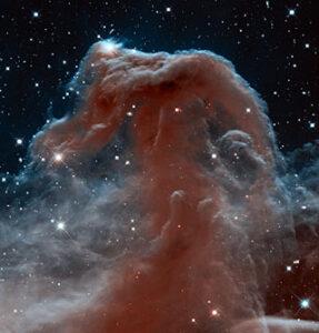 Jedna z prvních unikátních fotografií, která byla představena k výročí 23. let HST na oběžné dráze - mlhovina Koňská hlava v souhvězdí Orionu.