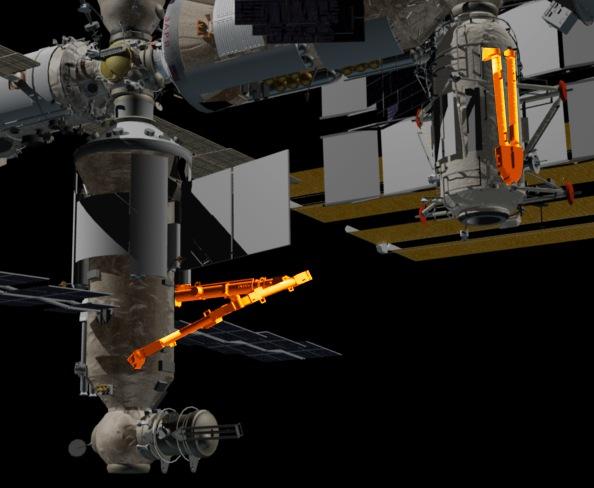 Vlevo modukl Nauka s barevně vyznačenou paží ERA - část vyznačená vpravo na modulu Rassvět je náhradní díl.