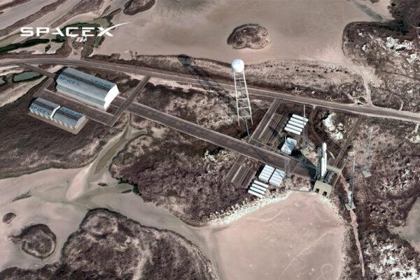 Vizualizace soukromého kosmodromu s raketou Falcon Heavy na rampě.