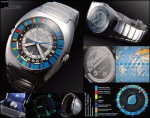 Hodinky Kosmonvigator - modrá ručička ukazuje na barevný proužek. Každá část Země má přidělenou jinou barvu. Viz legenda v pravém dolním rohu. Zdroj: http://www.netgrafik.ch