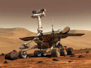 Počítačová vizualizace ukazuje rover  při práci robotického ramene.