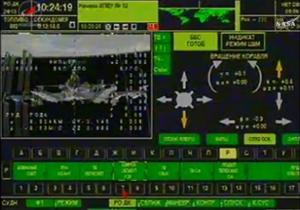 Řídící počítač Sojuzu TMA-16M během přeparkovávání. Zdroj: NASA.tv