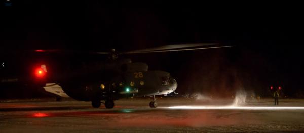 Přistávající vrtulník
