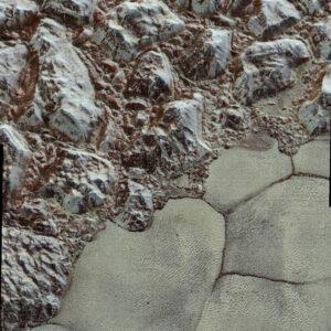 Povrch Pluta detailně a v barvě. Foto:: NASA/JHUAPL/SwRI