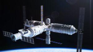 Nákladní loď TainZhou kotvící u budoucí kosmické stanice z více modulů
