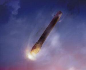 Vracející se první stupeň Falconu 9