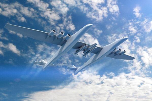 Kresba letounu Stratolaunch s trojicí podvěšených raket Pegasus XL