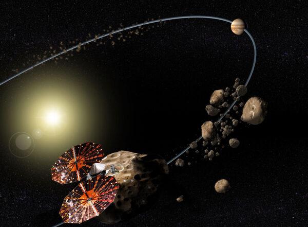 Vizualizace sondy Lucy při průletu kolem jupiterových Trojánů.